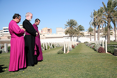 Dr Anis, Dr Williams and Dr Musk pray at Commonwealth War Graves Cemetery
