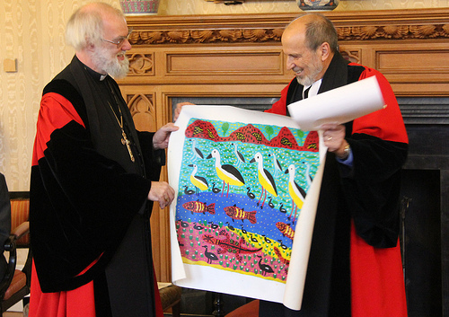 The Revd Dr John Harris presents the Archbishop with Aboriginal artwork