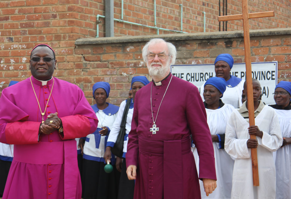 Members of the displaced congregation in Rusape with Archbishop Rowan and Bishop Julius Makoni
