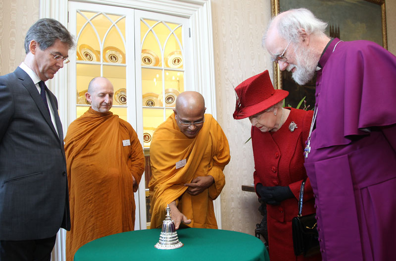 Buddhist guests and their sacred object - a silver Stupa