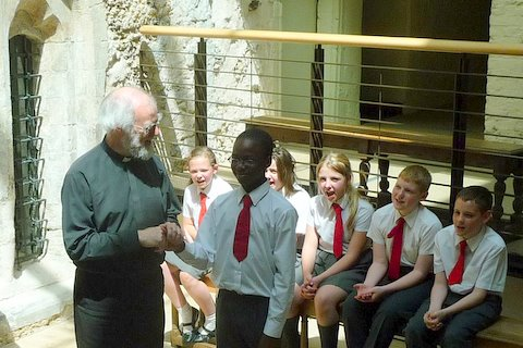 Archbishop and pupils sing Happy Birthday to Success