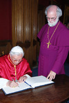 Pope Benedict signs the visitors' book at Lambeth Palace